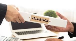 Business Valuations: Man passing valuation to another.