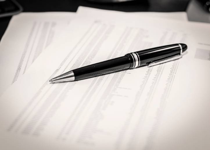 Pen laying on a report